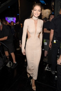 Gigi in nude crocodile dress by Julien Macdonald