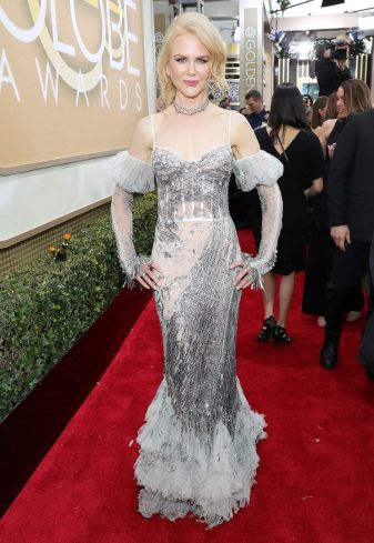 Nicole Kidman always looks beautiful especially in this McQueen. But the addition of the sleeves make it look dated and almost like a costume.